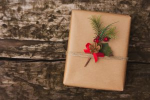 Christmas gift box on wooden background
